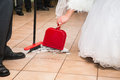 Wedding sweep up bride and groom the pieces of happiness Royalty Free Stock Image