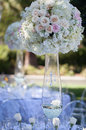 Wedding table decor and flower bouquet center piece with settings Stock Photos