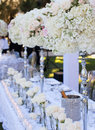 Wedding table decor and flower bouquet center piece with settings Stock Photography