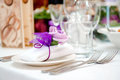 Wedding table decoration close up folded napkin empty glasses and forks Royalty Free Stock Images