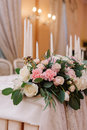 Wedding table decoration in the tenderly light pink style with roses, carnations and candles Royalty Free Stock Photo