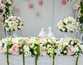 Wedding table with flowers arrangements Stock Photography