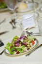 Wedding table with green salad Royalty Free Stock Photography