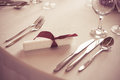 Wedding table place setting cutlery or dinner fork spoon and knife in elegant colorized photo Stock Photos