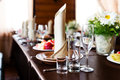 Wedding table in restaurant with flower composition Royalty Free Stock Photo