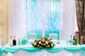 Wedding table in the restaurant with flower composition Royalty Free Stock Photo