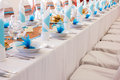 Wedding table set blue and brown decorations heart shaped gingerbread on the plate and salt cake plates on the Stock Photo