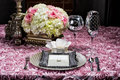 Wedding table setting image of a place at a on pink Stock Image