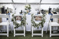 Wedding table under tent, with Mr and Mrs signs