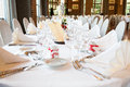 Wedding table view of a in france with white tablecloth Stock Photo