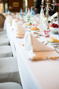 Wedding table view of a in france with white tablecloth Royalty Free Stock Photos