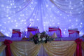 Wedding tables setting an image of at a luxury hall purple lights Royalty Free Stock Images