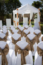 Wedding tent with chairs on lawn a chapel decorated placed the grass in front Stock Image
