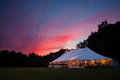 Wedding tent at night an event in a field sunset during a Stock Photos