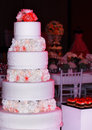 Wedding tier cake decorated with roses close up beautiful flowers decoration for Royalty Free Stock Images