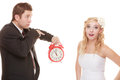 Wedding. Time to get married. Bride groom with clock. Royalty Free Stock Photo