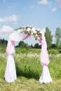 Wedding traditional arch with flower decor on blue sky background Royalty Free Stock Photo