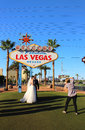Wedding at the welcome to fabulous las vegas sign photograph is taking a picture of a newly married couple on strip Stock Photography