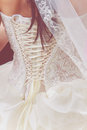 Wedding white dress with lace brides back in Royalty Free Stock Photos