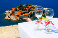 Wedding wineglasses on background of s stefan island montenegro Royalty Free Stock Photography