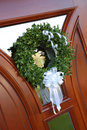 Wedding wreath with white bow on door Royalty Free Stock Photography
