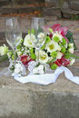 Weddings glasses for champagne and bouquet Stock Photos