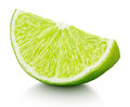 Wedge of green lime citrus fruit isolated on white