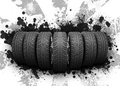 Wedge of new car wheels black blotches and gray abstract background is stripes at center Royalty Free Stock Photos