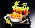 Wedges with raw vegetable and dip Royalty Free Stock Photo
