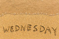 Wednesday - hand-written on the sand in line of the sea surf. Abstract. Royalty Free Stock Photo
