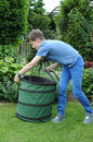 Weeding teenager boy the beds in the garden Royalty Free Stock Photo