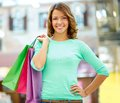 Weekend shopper portrait of a girl holding shopping bags and smiling at camera Royalty Free Stock Image
