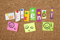 Weekend single letters and smiley faces pinned on cork noticeboard Royalty Free Stock Photo