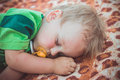 Weet blond little boy asleep on a blanket with yellow pacifier Royalty Free Stock Image