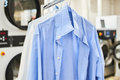 Weigh clean shirts on hangers Royalty Free Stock Photo