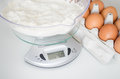 Weighing flour Royalty Free Stock Photo