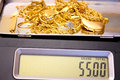Weighing gold Royalty Free Stock Photo