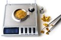 Weighing of gold balance precision to weigh spangles rivère Stock Photos