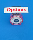 Weighing the options text in red letters on white card placed on top of small scale giving concept of blue background Royalty Free Stock Photography