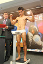 Weighing underwear boxer on press conference Royalty Free Stock Images