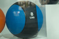 Weight ball 8 lbs behind glass Royalty Free Stock Photo