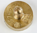 Weight of five grams made from brass with hallmarks Stock Image