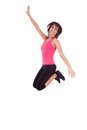 Weight loss fitness woman jumping joy isolated white background Stock Photo