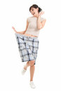 Weight lost woman in big trousers, full length Royalty Free Stock Photo