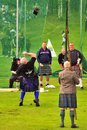 Weight over the bar event highland games this at royal at braemar is called a lb is thrown a horizontal Royalty Free Stock Photos