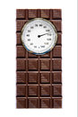 Weight scale and chocolate a piece of with a on it Stock Image
