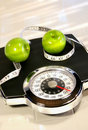 Weight scale with green apples Royalty Free Stock Photography