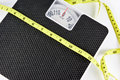 Weight scale and measuring tape. Royalty Free Stock Photo
