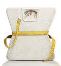 Weight scale with a measuring tape over white Royalty Free Stock Photo