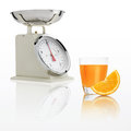 Weight scale with orange juice glass isolated on white backgroun Royalty Free Stock Photo